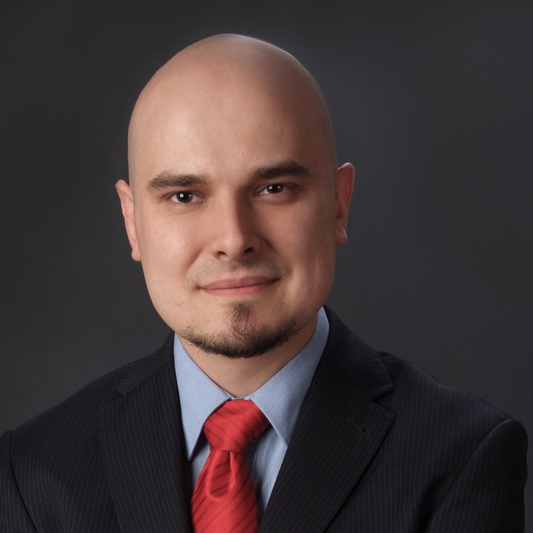 dr Michał Kuź